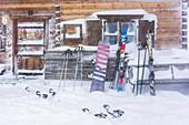 Germany, Bavaria, Alps, Oberallgaeu, Oberstdorf, Winter Holidays, Winter Sports, Relaxing in an alpine hut during a blizzard