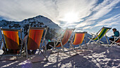 Austria, Germany, Bavaria, Alps, Oberallgaeu, Oberstdorf, Kleinwalsertal, Kanzelwand, Winter landscape, Winter holidays, Winter sports, Relaxing on the summit in deckchairs
