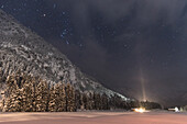 Germany, Bavaria, Oberallgaeu, Oberstdorf, Stillachtal, Alps, winter landscape at night, starry sky, winter holidays, mountain farm at night in snow, snowfall, mountains, coniferous forest, pines