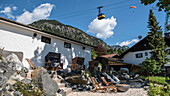 Germany, Bavaria, Alps, Oberallgaeu, Oberstdorf, Summer holidays, Somerurlaub, Relaxing at a gastronomy, Nebelhorn Mountain railway in the background, Hiking