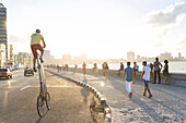 Man on a bicycle at Malecon, historic town center, old town, Habana Vieja, Habana Centro, family travel to Cuba, holiday, time-out, adventure, Havana, Cuba, Caribbean island