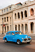 blue oldtimer, tourists, driving along Malecon, taxi, historic town, center, old town, Habana Vieja, Habana Centro, family travel to Cuba, holiday, time-out, adventure, Havana, Cuba, Caribbean island
