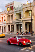 red oldtimer, cabriolet, tourists, driving along Malecon, taxi, historic town, center, old town, Habana Vieja, Habana Centro, family travel to Cuba, holiday, time-out, adventure, Havana, Cuba, Caribbean island