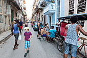 Street scene in Havana Vieja, men playing dominos, rickshaws, nearly no cars on the street, historic town, center, old town, Habana Vieja,  family travel to Cuba, parental leave, holiday, time-out, adventure, MR, Havana, Cuba, Caribbean island