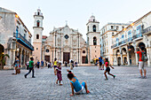 Cathedral at Havana Vieja, Plaza de la Cathedrale, children playing football on the square, historic town, center, old town, Habana Vieja,  family travel to Cuba, parental leave, holiday, time-out, adventure, Havana, Cuba, Caribbean island