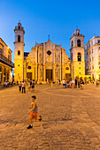 Cathedral at Havana Vieja, Plaza de la Cathedrale, children playing on the square, historic town, center, old town, family travel to Cuba, parental leave, holiday, time-out, adventure, Havana, Cuba, Caribbean island