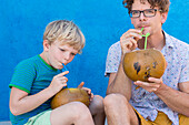 Father and son drinking from a coconut, Playa Larga, family travel to Cuba, parental leave, holiday, time-out, adventure, MR, Playa Larga, bay of pigs, Cuba, Caribbean island