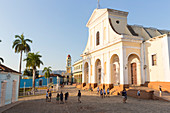 Iglesia Parroquial de la Santisima Trinidad at Plaza Mayor in the background the bell tower of Museo Nacional de la Lucha, formerly Iglesia y Convento de Sa, family travel to Cuba, parental leave, holiday, time-out, adventure, Trinidad, province Sancti Sp