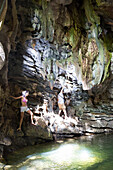 tourists visiting a cave during a hike through the national park Topes de Colantes, family travel to Cuba, parental leave, holiday, time-out, adventure, near Trinidad, province Sancti Spiritus, Cuba, Caribbean island