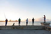 tourists, local people and fisherman at Malecon, historic town, center, old town, Habana Vieja, Habana Centro, family travel to Cuba, holiday, time-out, adventure, Havana, Cuba, Caribbean island
