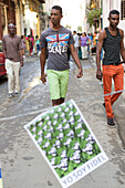 young cuban man, poster ''I am Fidel'', yo soy Fidel, veneration of Fidel Castro, walking through Habana Vieja, family travel to Cuba, holiday, time-out, adventure, Havana, Cuba, Caribbean island