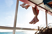 Family dangling their feet, boat trip to Cayo Levisa, beach holiday, tourists, lonely beach at Cayo Levisa, beautiful small sandy beach, turquoise blue sea, palm tree, family travel to Cuba, parental leave, holiday, time-out, adventure, Cayo Levisa, day t