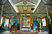 Inside a church with flowers and unusual paintings, Garove Island, Vitu Islands, West New Britain, Papua New Guinea, South Pacific