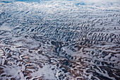 Aerial of heavily folded snow-covered landscape seen from a helicopter, near Petropavlovsk-Kamchatsky, Kamchatka, Russia, Asia