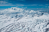 Aerial of snowy mountainous landscape with numerous thin lakes viewed from a helicopter, near Petropavlovsk-Kamchatsky, Kamchatka, Russia, Asia