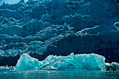 A large iceberg of translucent ice floats in front of the Sawywer Glacier, Tracy Arm, Stephens Passage, Tongass National Forest, Tracy Arm-Fords Terror Wilderness, Alasksa, USA, North America