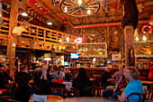 Patrons sit in the wild west atmosphere of the Red Dog Saloon, Juneau, Alaska, USA, North America
