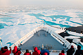 Passengers of the expedition cruiseship MS Bremen (Hapag-Lloyd Cruises) gather in early morning on the decks to view the edge of the pack-ice, near Prince of Wales Island, Nunavut, Canada, North America