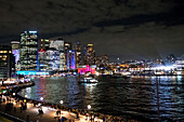 The ferry terminal of Circular Quay with city during the Vivid Festival, Sydney, New South Wales, Australia