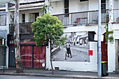 A terraced house, decorated with a historic photograph, in the suburb of Redfern, Sydney, New South Wales, Australia