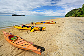 Three kayaks laying in bay, Abel Tasman Coastal Track, Great Walks, Abel Tasman National Park, Tasman, South island, New Zealand