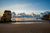 Coloured cliffs and sunrise at the beach, Praia da Dona Ana, Lagos, Algarve, Portugal