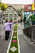 People arranging petals on the floor, Corpus Christi, Feast of Corpus Christi, procession, Sipplingen, Lake Constance, Baden-Wuerttemberg, Germany, Europe
