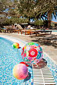 beach ball in the hotel pool, garden, Agia Galini, Crete, Greece, Europe