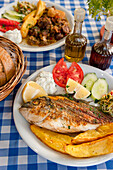 Greek food, Grilled fish with salad, main course, Plakias, Crete, Greece, Europe
