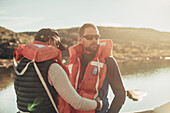 Hikers put on life jackets , greenland, arctic.