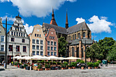 new market, street cafe, St Marys church , Marienkirche, Rostock , Mecklenburg-Vorpommern, East Germany
