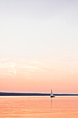 Lonely Yacht at the Sunset at the Ammersee lake