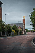 lit church tower at deserted multi lane road, Belfast, Northern Ireland, United Kingdom, Europe