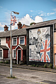 decayed UK flag and murals in Eastern Belfast, Northern Ireland, United Kingdom, Europe