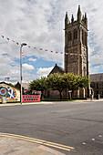 murals next to church tower, Eastern Belfast, Northern Ireland, United Kingdom, Europe