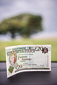 twenty pound banknote in car afer border crossing, Northern Ireland, United Kingdom, Europe