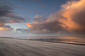 Sandy beach in evening light at storm, North Sea, Wattenmeer National Park, Schillig, Wangerland, Friesland District, Lower Saxony, Germany, Europe