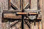 An old door lock to a wooden shed on the wine route, Margreid, South Tyrol, Alto Adige, Italy