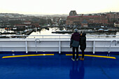 young couple on ferry ship viewing port in Gothenburg, Sweden