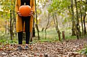 Girl with pumpkin on Halloween, Hamburg, Germany