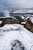 footprints of birds in the fresh snow near Funningur, Eysturoy, Faroe Islands, Denmark