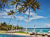 Swimming pool of Candi Beach Resort and Spa with a view towards Sengkidu Beach. Candidasa, Manggis subdistrict, Karangasem regency, Bali, Indonesia.