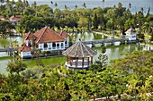 Gili Bale, main building of the Ujung Water Palace (Taman Ujung), surrounded by water and landscaped garden. Karangasem Regency, Bali, Indonesia.