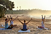 Yoga class on the beach beside the Sen Wellness Sanctuary, near Tangalle, South Coast of Sri Lanka, Indian subcontinent, South Asia.