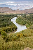 Big Bend National Park, Texas - The Rio Grande (Rio Bravo del Norte), the international border between the United States and Mexico. The Chisos Mountains are in the distance.