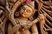 Carved idol on the outer wall, Hatkeshwar Mahadev, 17th century temple, the family deity of Nagar Brahmins. Vadnagar, Gujarat, India.