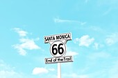 Minimalist scene of the Route 66 End of the Trail sign on Santa Monica Pier in California