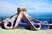 Sculpture of an octopus on the waterfront in La Coruna - Galicia, Spain.
