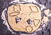 Cut out from the dough shape for baking cookies, top view.