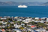 New Zealand, North Island, Wellington, elevated view of Seatoun from the Pass of Branda with cruiseship.